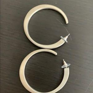 Hoop earrings silver in color
